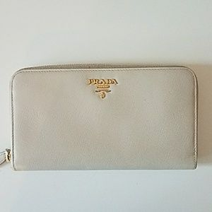 Prada creme saffiano leather zip around wallet